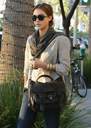 Jessica Alba looked California cool carrying a Proenza Schouler PS1 bag. The weathered looking black leather flap front bag was the perfect purse for hitting Beverly Hills shops.