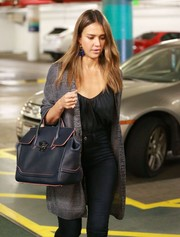 Jessica Alba was cozy and cute in a gray knit cardigan while visiting a medical building.