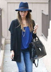 Jessica Alba hid away in a navy wide brimmed hat while out and about in Hollywood.