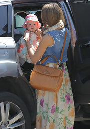 Jessica Alba protected her little one's pale complexion from the sun in an embroidered eyelet sun hat.