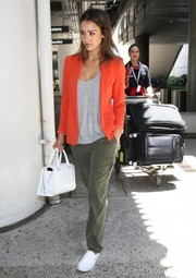 Jessica Alba was tough-chic in army-green Sanctuary cargo pants teamed with an orange blazer during a flight to LA.