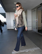 Jessica Alba kept things casual in a furry vest and dark wash flares.