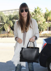 Jessica Biel traveled in style toting around this classic and structured black top-handle.