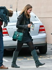 Jessica Alba's teal boots popped against her all-black attire.