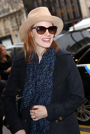 Jessica Chastain wore a patterned leopard print scarf for her visit to Paris.