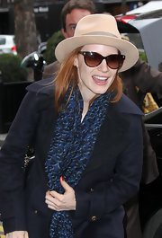 Jessica Chastain tossed on a fedora for her visit to Paris.