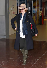 Jessica Chastain kept warm in Paris in a chic navy wool coat with gold military style buttons.