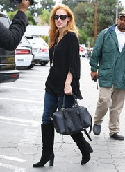 Jessica Chastain looked stylish in knee-high suede boots while shopping in Brentwood.