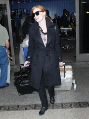 Jessica Chastain landed at LAX looking stylish in a black trenchcoat.
