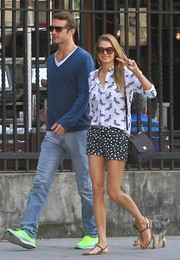 Jessica Hart mixed a pair of polka-dot shorts with a butterfly-print button-down for a stroll around Soho.