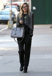 Jessica Hart teamed her jacket with slacks and a tee for an edgy all-black finish.