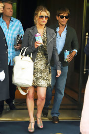 Jessica Simpson was seem leaving her NYC hotel in an army print dress. Feminine and edgy all at once.