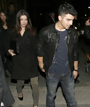 Ashley Greene hit the town with a black leather clutch.