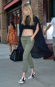 Gigi Hadid was spotted out in New York City wearing a pair of J Brand utility pants with a black crop-top.