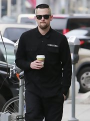The days of Good Charlotte may be long over, but Joel Madden definitely is still dressing the part of rock star, as he showed when he sported this punk-style button down.