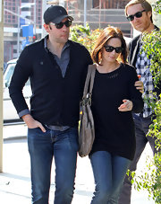 Emily Blunt looked relaxed in a black open knit sweater and jeans.