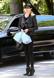 Chrissy Teigen looked like a rock star in her step-hem skinny jeans and leather jacket while out in Bel-Air.