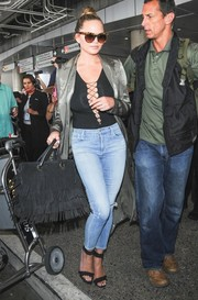 Chrissy Teigen was a head turner at LAX in a black T by Alexander Wang lace-up bodysuit.