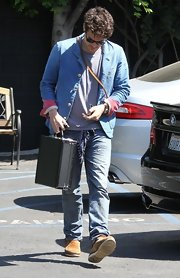 John Mayer's light blue blazer had a summery feel to it when paired over a tee.