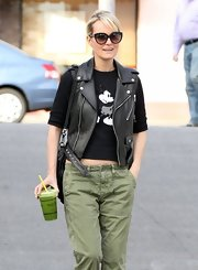 Laeticia Hallyday mixed playful and edgy by pairing a Mickey Mouse top with a leather vest.