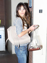 Jordana Brewster added luxury to her low-key look with an ivory leather tote.