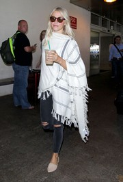 Julianne Hough bundled up in a striped shawl for a flight.