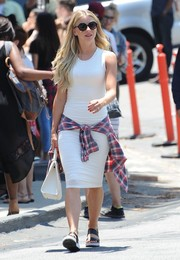 Julianne Hough went to church wearing a white tank dress that displayed her athletic physique.