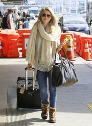 Julianne Hough kept her feet toasty in a pair of fur-lined boots for a flight out of LAX.