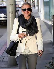 Julianne Hough looked polished in Hollywood in a white blazer and plaid scarf.