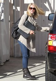 Julianne Hough matched her relaxed vibe with a slouchy black leather bag.
