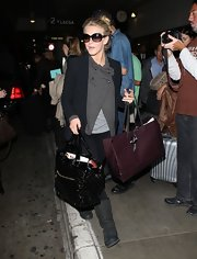Julianne Hough made her way to LAX toting a quilted black patent tote stuffed to the brim.