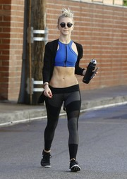 Julianne Hough stepped out of the gym showing off her ripped abs in a blue racer-neckline sports bra.