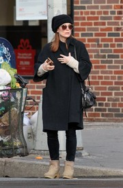 Julianne Moore completed her cold-weather ensemble with a pair of sheepskin boots.