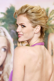 Brooklyn Decker should off her backless dress with a textured french twist.