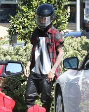 Justin Bieber put on a black motorcycle helmet for a day of cruising.