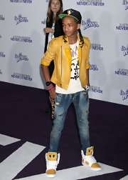 Jaden Smith added a sporty feel to his look with a pair of yellow and white basketball sneakers.
