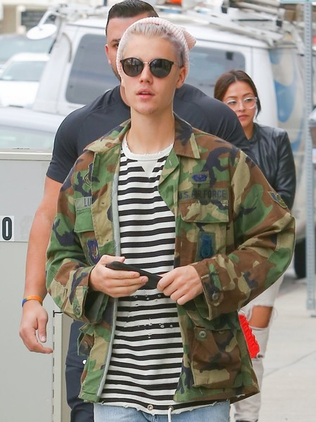 Justin Bieber accessorized with a pair of round shades while strolling in Beverly Hills.