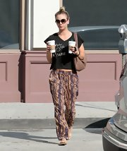 Kaley looked boho chic in tribal-print harem pants.
