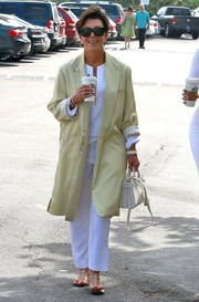 Kris Jenner attended Easter service looking bright in a yellow coat layered over a white blouse and slacks.