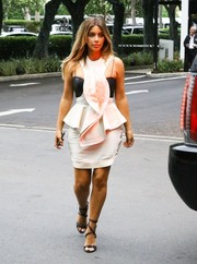 Kim Kardashian looked a little OTT in a frilly white peplum dress as she did some Black Friday shopping in Miami.