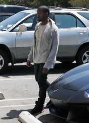Kanye West topped off his casual look with a pair of Air Jordan sneakers while leaving the mall.