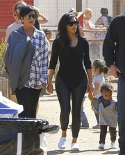 Kim Kardashian enjoyed a day out at Underwood Family Farms wearing a leotard-like scoopneck sweater with leather leggings.