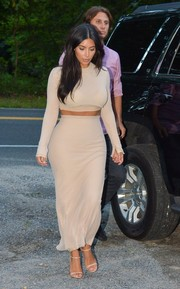 Kim Kardashian matched her top with a nude LaQuan Smith maxi skirt.