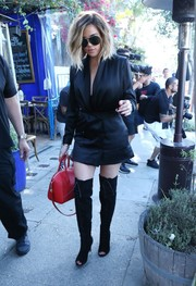 Khloe Kardashian polished off her fierce look with black thigh-high lace-up boots by Gianvito Rossi.