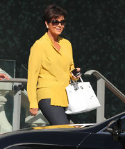Kris Jenner looked bright and cheery in a sunny yellow blouse.