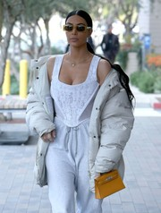 Kim Kardashian kept her famous curves under control in a white corset top by Vivienne Westwood while out in Calabasas.