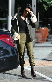 For her footwear, Kourtney Kardashian chose a pair of black mesh ankle boots by Yeezy.