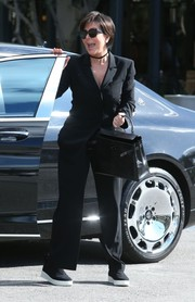 Kris Jenner kept her feet comfy in a pair of black-and-white slip-ons.