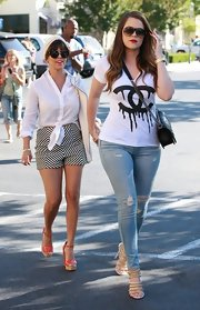 Khloe chose ripped skinny jeans while out with her sister and mom.
