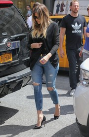 Khloe Kardashian kept it low-key in a black cardigan and ripped jeans while out for lunch in NYC.